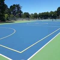 Blue court with green surrounds